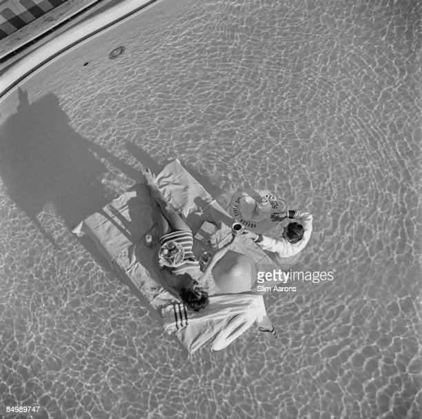 Austrian actress Mara Lane enjoys waiter service in the pool at the Sands Hotel Las Vegas 1954
