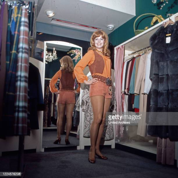 Austrian actress Monika Strauch at a clothes shop, Germany, 1970s.