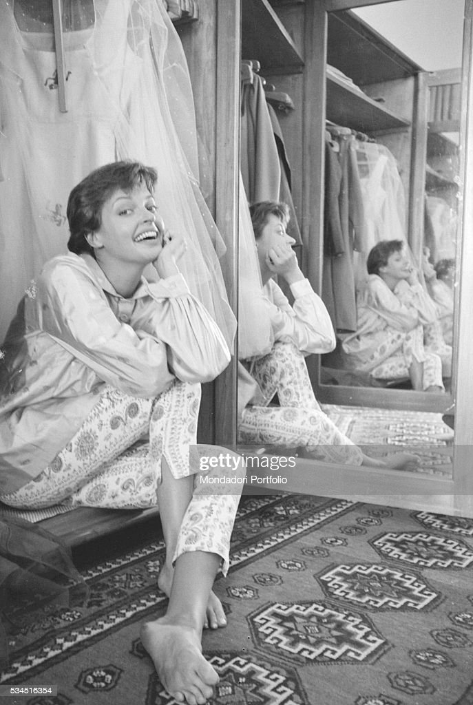 Austrian actress Nadja Tiller smiling beside a mirror during the 19th Venice International Film Festival. Venice, August 1958