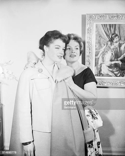 Austrian actress Romy Schneider attends a cocktail party with her mother, stage and film actress Magda Schneider, in the penthouse at Walt Disney...