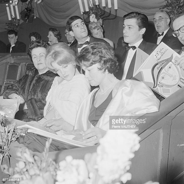 Austrian actress Romy Schneider attends the opening night of a play with her mother, stage and film actress Magda Schneider. Directly behind them is...