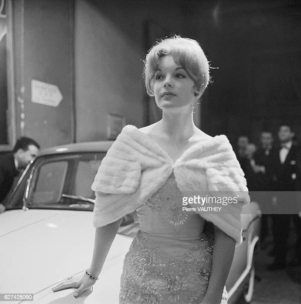 Austrian actress Romy Schneider wears a beaded evening gown and fur stole for the opening night of a play She attended the premiere with her mother...