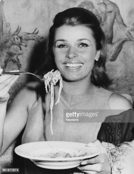 Austrian actress Senta Berger eating spaghetti in the Cinecitta Studios in Rome Italy during the filming of 'Operazione San Gennaro' September 1966
