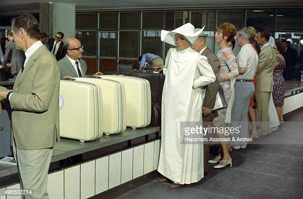 Austrian actress Senta Berger getting her luggage at the airport in the film Treasure of San Gennaro Naples 1966