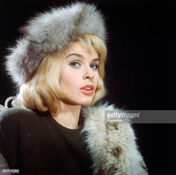 Austrian actress Senta Berger posed wearing a fur coat and hat on the set of the film 'The Victors' in 1963