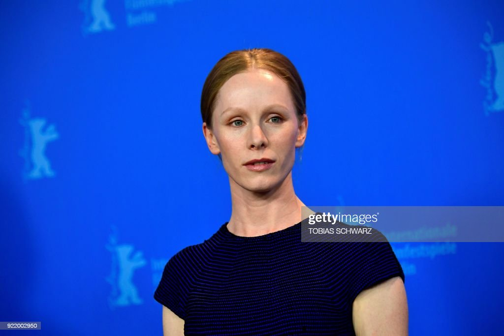 Austrian actress Susanne Wuest poses during the photo call for the film 'My Brother's Name is Robert and He is an Idiot' (Mein Bruder heisst Robert und ist ein idiot) presented in competition during the 68th edition of the Berlinale film festival in Berlin on February 21, 2018. / AFP PHOTO / Tobias SCHWARZ