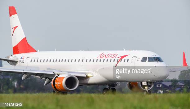 "austrian airlines embraer erj-195l landing at schiphol airport - ""sjoerd van der wal"" or ""sjo"" stock pictures, royalty-free photos & images"