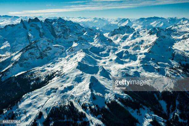 austrian alps in winter seen from plane - sonnig stock pictures, royalty-free photos & images