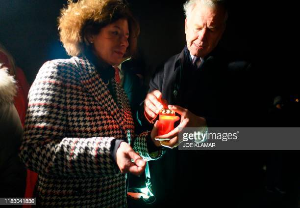 Austrian Ambassador to Slovakia Margit BruckFriedrich and Regional Manager of Lower Austria Martin Eichinger light up a candle at the Freedom...