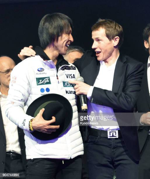 Austrian Andreas Goldberger threetime overall World Cup champion congratulates Japanese ski jumper Noriaki Kasai during a celebration in Bad...