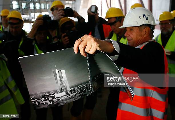 Austrian architect Wolf Prix of CooP Himmelblau displays a brochure of the new European Central Bank headquarters during a media tour on September 20...
