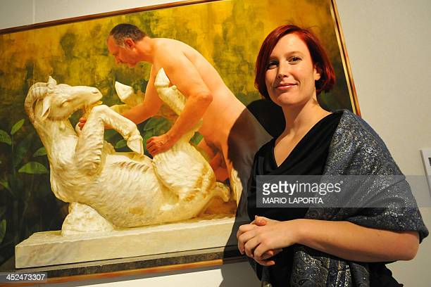 Austrian artist Veronika Bayer posed by a picture of her colleague Daniel Feyer superimposed on an erotic fresco at the Casoria Contemporary Art...