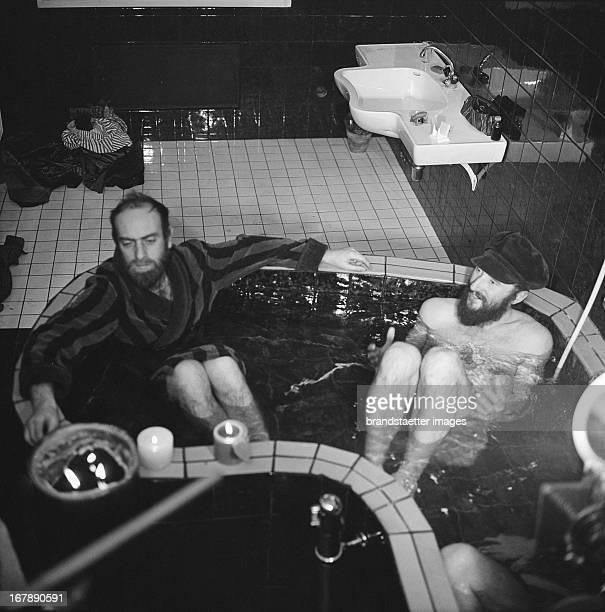 Austrian artists Friedensreich Hundertwasser and Ernst Fuchs in the bath tub in the studio of Hundertwasser Spiegelgasse 2 Vienna February 1st 1968...