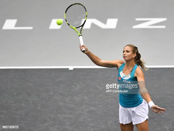 Austrian Barbara Haas returns to German Carina Witthoeft during the WTA Ladies tennis match in Linz, Upper Austria, on October 11, 2017. / AFP PHOTO...