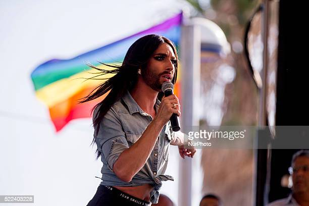 Austrian bearded drag queen Conchita Wurst sings at a gay pride parade in Tel Aviv Israel on June 12 2015 According to organisers and police about...
