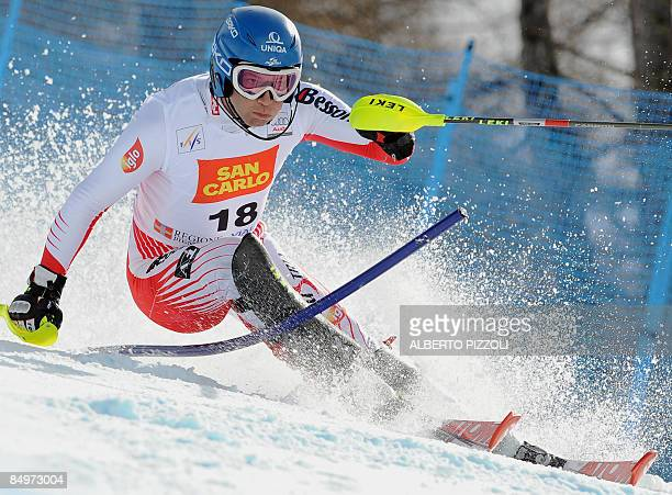 Austrian Benjamin Raich clears a gate in the giant Slalom the second run of the Super combined event during the men's skiiing world cup in Sestriere...