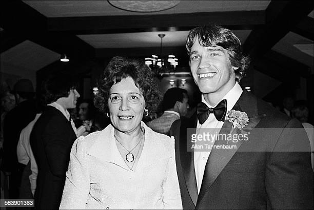 Austrian bodybuilder and actor Arnold Schwarzenegger and his mother Aurelia attend the premiere of Schwarzenegger's film 'Pumping Iron' New York New...