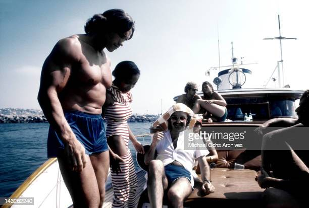 Austrian Bodybuilder and actor Arnold Schwarzenegger and Italian composer and producer Giorgio Moroder have some fun at a party on a yacht in Marina...
