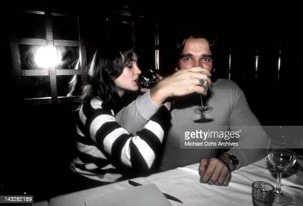 Austrian Bodybuilder and actor Arnold Schwarzenegger has drinks with his girlfriend with his girlfriend in February 1979 in Los Angeles California