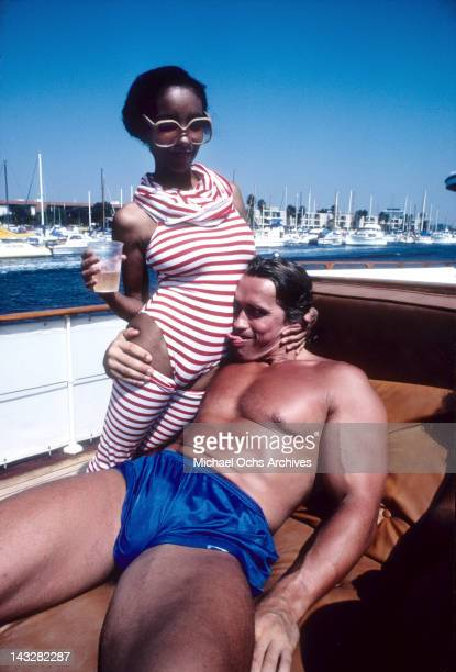 Austrian Bodybuilder and actor Arnold Schwarzenegger has some fun at a party on a yacht in Marina Del Rey in September 1979 in Los Angeles California