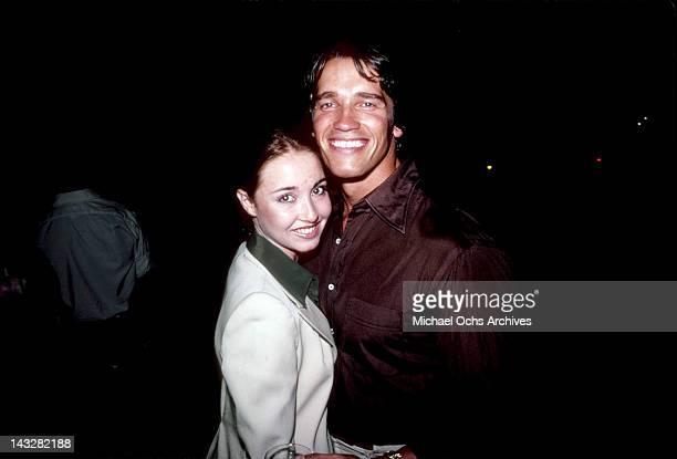 Austrian Bodybuilder Arnold Schwarzenegger attends an event with his girlfriend in August 1977 in Los Angeles California