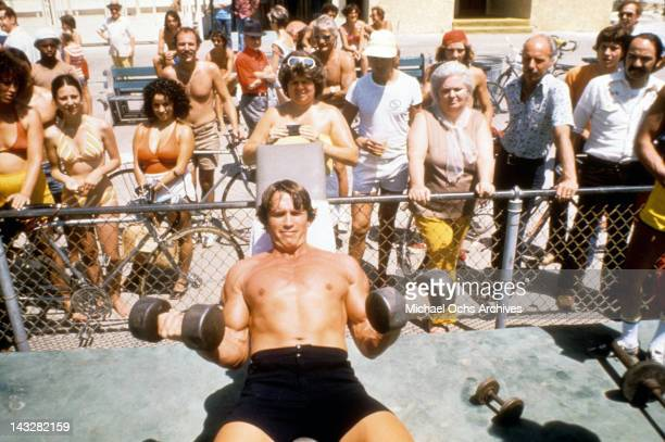 Austrian Bodybuilder Arnold Schwarzenegger lifts weights at Muscle Beach in Venice in August 1977 in Los Angeles, California.