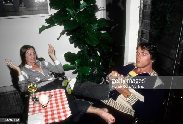 Austrian Bodybuilder Arnold Schwarzenegger plays with his girlfriends foot in April 1977 in Los Angeles California