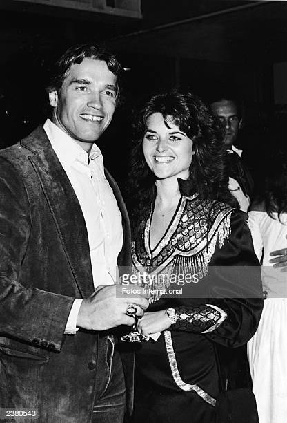 """Austrian born actor Arnold Schwarzenegger and girlfriend Maria Shriver pose at SHARE's 29th annual """"Boomtown Party"""" benefit at the Santa Monica Civic..."""