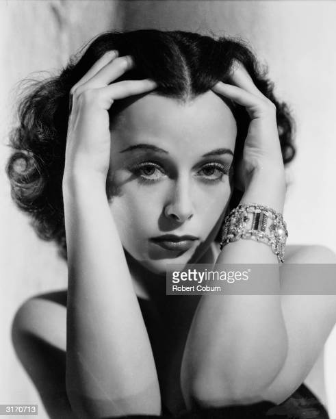 Austrian born actress Hedy Lamarr clasping her head