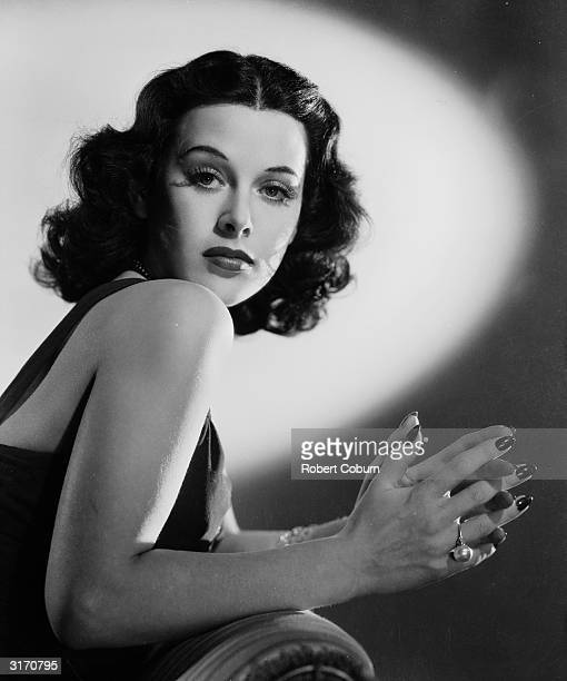 Austrian born actress Hedy Lamarr posing with clasped hands.