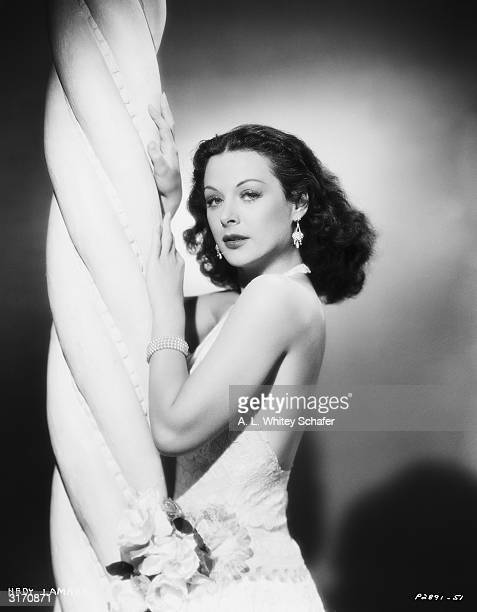 Austrian born actress Hedy Lamarr wearing a backless dress designed by Edith Head