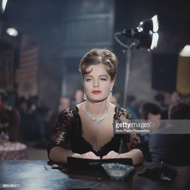 Austrian born actress Romy Schneider pictured wearing a black lace dress on the set of a film in 1965