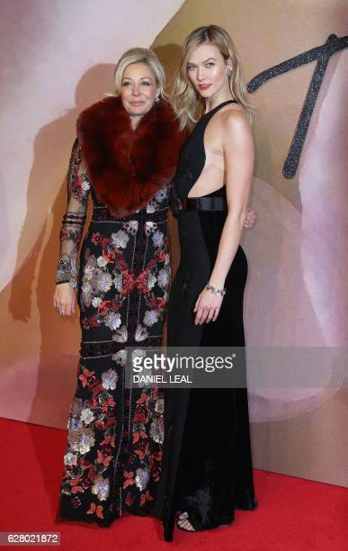 Austrian businesswoman Nadja Swarovski and model Karlie Kloss pose for pictures on the red carpet upon arrival to attend the British Fashion Awards...