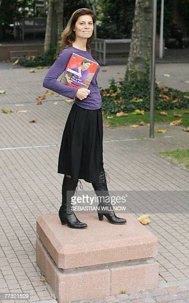 Austrian celebrity chef Sarah Wiener poses for a photo with her new cook book at the Frankfurt Book Fair 12 October 2007 The fair the world's biggest...