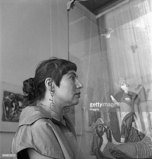 Austrian ceramist Maria Biljan-Bilger in the Austrian pavillion at the Venice Biennale. 1954. Photograph by Barbara Pflaum .