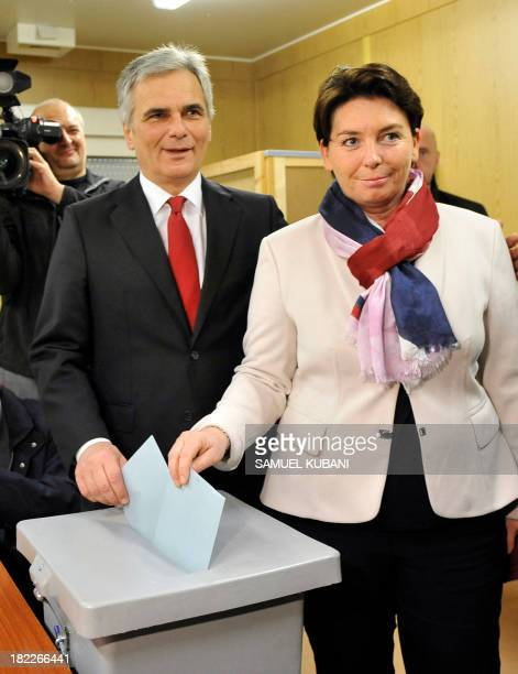 Austrian chancellor and candidate of the Sozialdemokratische Partei Oesterreichs SPO for Austria's legislative elections Werner Faymann and his wife...