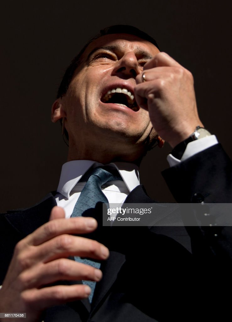 Austrian Chancellor and leader of the Social Democrats (SPOe) Christian Kern speaks to supporters during the last election rally on the eve of the Austrian parliamentary elections on October 14, 2017 in Vienna, Austria. Austria holds snap general elections on Sunday, October 15, 2017. /