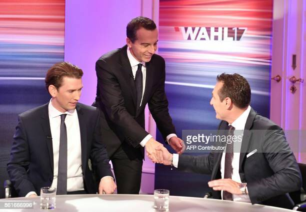 Austrian Chancellor and leader of the Social Democrats Christian Kern and HeinzChristian Strache chairman of Austria's farright Freedom Party shake...