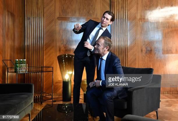 Austrian Chancellor Sebastian Kurz and European Council President Donald Tusk look at an art work on February 13 2018 at the Chancellery in Vienna...