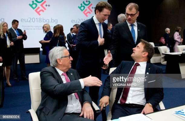 Austrian Chancellor Sebastian Kurz and Finnish Prime Minister Juha Sipila speak with European Commission President JeanClaude Juncker and...