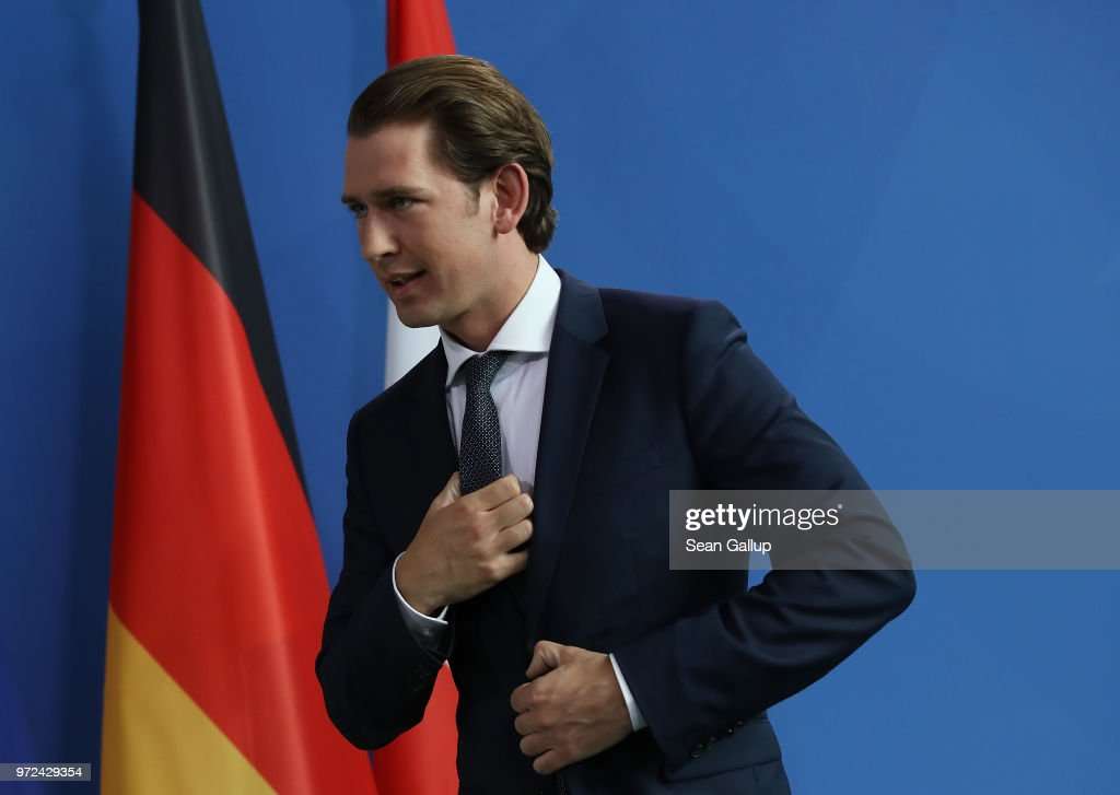 Austrian Chancellor Sebastian Kurz and German Chancellor Angeka Merkel (not pictured) depart after speaking to the media following talks at the Chancellery on June 12, 2018 in Berlin, Germany. High on the two leader's topics of discussion was migration policy.