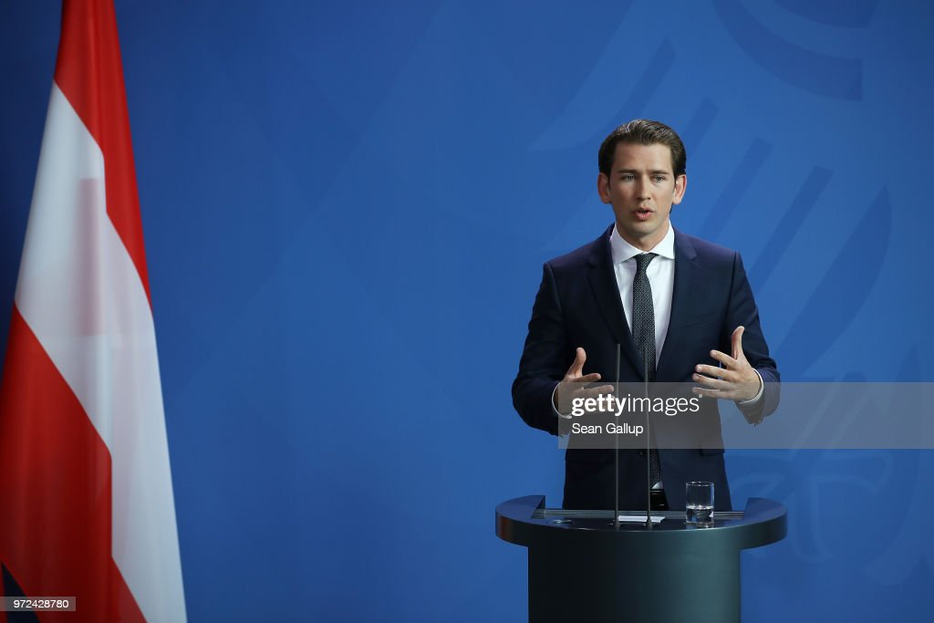 Austrian Chancellor Sebastian Kurz and German Chancellor Angeka Merkel (not pictured) speak to the media following talks at the Chancellery on June 12, 2018 in Berlin, Germany. High on the two leader's topics of discussion was migration policy.