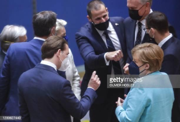 Austrian Chancellor Sebastian Kurz and German Chancellor Angela Merkel speak at the start of on the first day of a European Union summit at The...