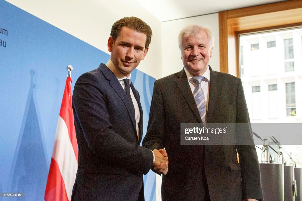 Austrian Chancellor Sebastian Kurz (L) and German Interior Minister Horst Seehofer shake hands following a press conference on June 13, 2018 in Berlin, Germany. Both men advocate a more hawkish policy towards migrants that includes refusing entry to those lacking visas or reasonable asylum grounds at the border and sending them back to their initial country of entry into the European Union. Seehofer and German Chancellor Angela Merkel have so far been at odds over this point, which has prevented the rollout of a common 'migration masterplan.'