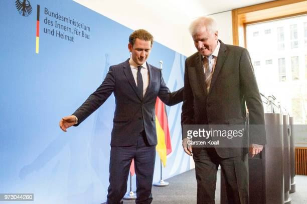 Austrian Chancellor Sebastian Kurz and German Interior Minister Horst Seehofer leave a finished press conference on June 13 2018 in Berlin Germany...