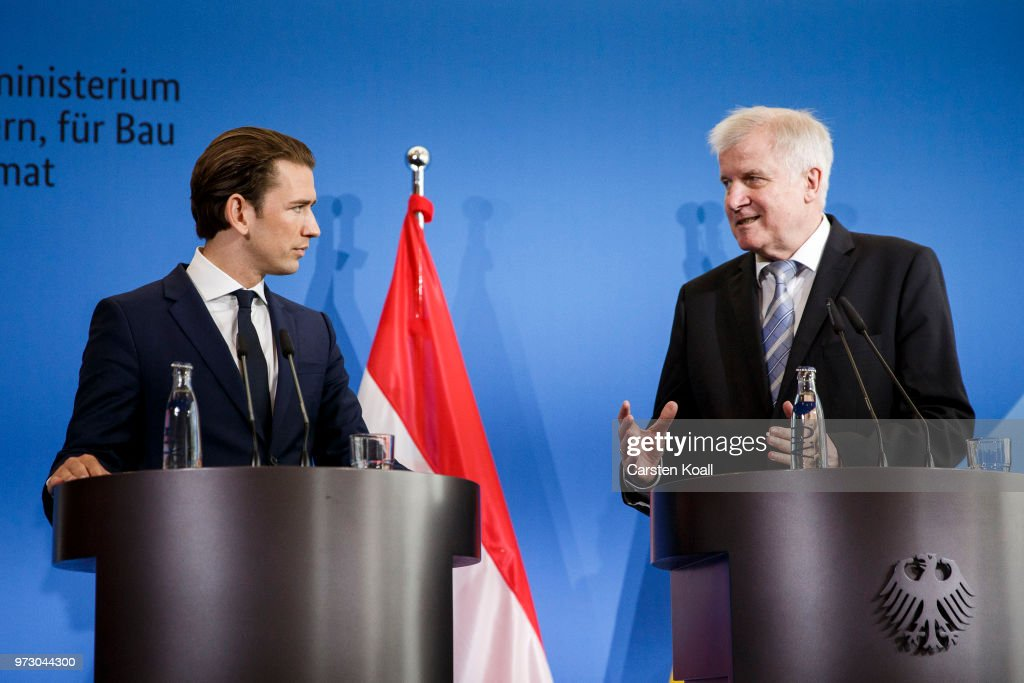 Austrian Chancellor Sebastian Kurz (L) and German Interior Minister Horst Seehofer (R) attend a press conference on June 13, 2018 in Berlin, Germany. Both men advocate a more hawkish policy towards migrants that includes refusing entry to those lacking visas or reasonable asylum grounds at the border and sending them back to their initial country of entry into the European Union. Seehofer and German Chancellor Angela Merkel have so far been at odds over this point, which has prevented the rollout of a common 'migration masterplan.'