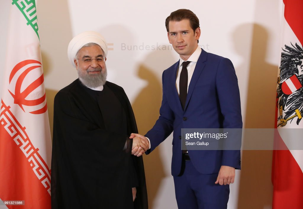 Austrian Chancellor Sebastian Kurz and Iranian President Hassan Rouhani shake hands at the Federal Chancellery on July 4, 2018 in Vienna, Austria. Rouhani is on a one-day visit to Austria, during which he is meeting with President van der Bellen and Chancellor Kurz and will attend an event at the Austrian Chamber of Commerce.