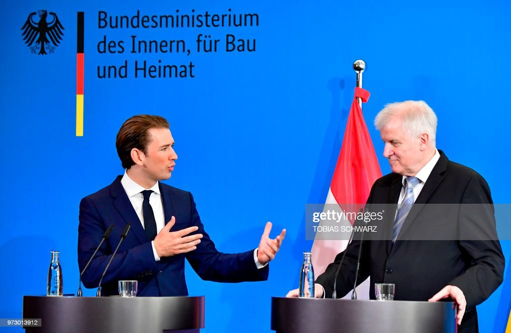 Austrian Chancellor Sebastian Kurz (L) gestures next to German Interior Minister Horst Seehofer during a press conference at the Interior Ministry in Berlin, on June 13, 2018.