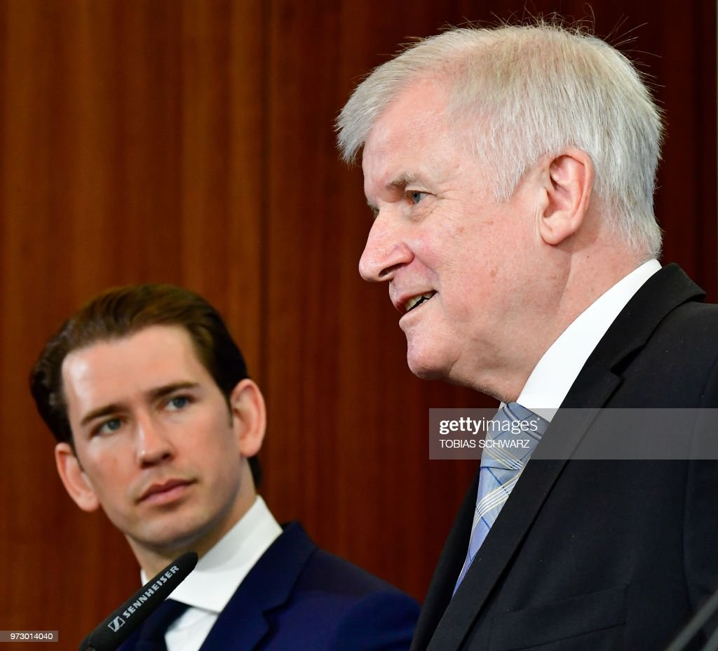 Austrian Chancellor Sebastian Kurz (L) looks on as German Interior Minister Horst Seehofer speaks during a press conference at the Interior Ministry in Berlin, on June 13, 2018.