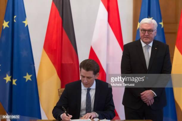 Austrian Chancellor Sebastian Kurz signs the Guestbook as German federal President FrankWalter Steinmeier stands in the Bellevue Castle on January 18...